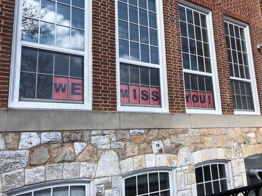 'We miss you!' sign in the windows of the Staunton Public Library.