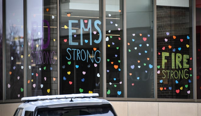 """Hundreds of brightly colored hearts are posted next to messages of hope and tribute to emergency and health-care workers on the windows near the emergency room entrance Friday, April 3, 2020, at St. Cloud Hospital. The hearts are posted as part of the """"A World of Hearts"""" movement to bring a message of positivity to communities in the wake of the COVID-19 crisis."""