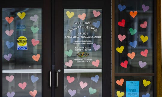 Hearts are posted near the entrance to Hillside Early Childhood Center Friday, April 3, 2020, in Sauk Rapids.