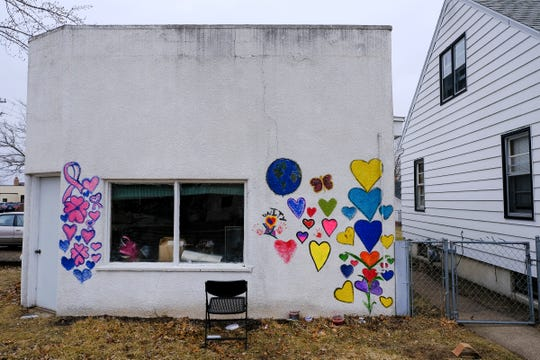 "Brightly colored hearts painted by community members decorate a wall of a former gas station on 19 1/2 Avenue North Friday, April 3, 2020, in St. Cloud. The hearts are part of the nationwide ""A World of Hearts"" movement."