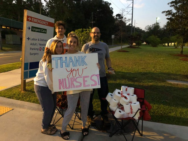 The Ricco family handed out rolls of toilet paper and Starbucks gift cards to nurses at Tallahassee Memorial HealthCare at 7 a.m. on Friday morning, April 3, 2020.