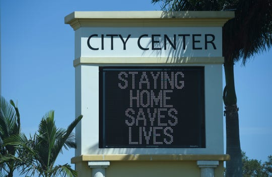 The Port St. Lucie Civic Center sign, as seen from U.S. 1, on Friday, April 3, 2020, encourages residents to stay safer at home to help stop the COVID-19 virus from spreading.