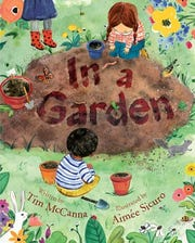 In a Garden by Tim McCanna and illustrated by Aimee Sicuro