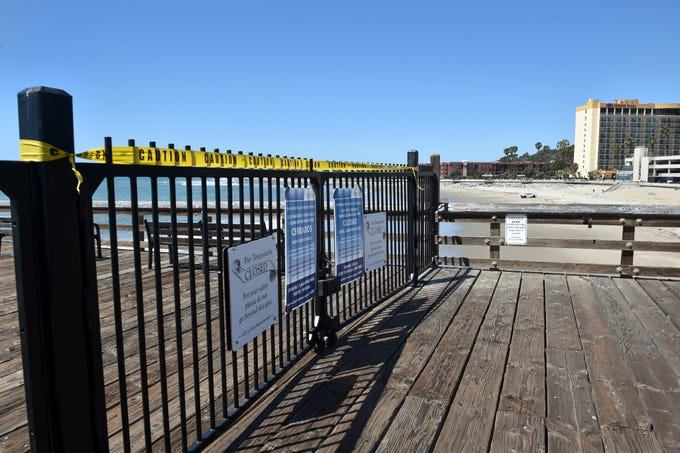 The Ventura Pier has been closed as government agencies urge the public to exercise social distancing to curb the spread of COVID-19.