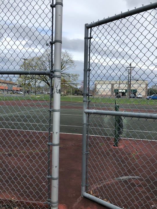 Vineland officials ordered basketball courts closed starting on April 3, 2020 to help stem the spread of COVID-19 Tennis courts, including these located off Chestnut Avenue, remain open.