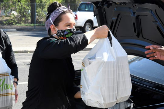 """Local meal prep company Precision Prep raised more than $1,100 in two days through its """"Feed the Frontlines"""" initiative. Owner Lauren Evangelho and assistant Arianna Gonzales prepared and delivered the first round of donated meals to Kaweah Delta Medical Center on Wednesday, April 1, 2020."""