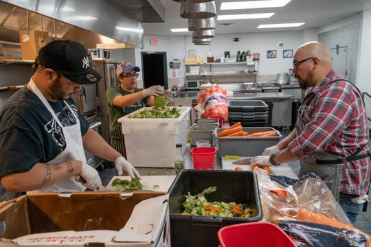 Chef Mike Anastacio, right of Fin & Brew in Peekskill in the kitchen preparing soup with his staff for the Million Gallons initiative.