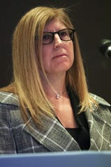 Dr. Karyl Rattay, director of the Delaware Division of Public Health (left) participates in a press conference led by Gov. John Carney on the coronavirus situation in the state from the Carvel State Building Friday.