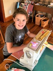 Mairin Mullett sews a homemade mask as part of efforts through Mercantile on Main to provide masks to those in need locally.