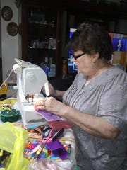 Patsy Cruxton of Coshocton Canal Quilters works on homemade masks for donation to a variety of entities in need during the COVID-19 pandemic.