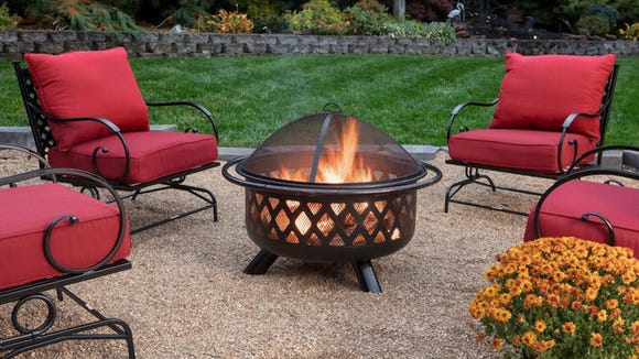Nothing says cozy like an outdoor fire pit on a spring evening.