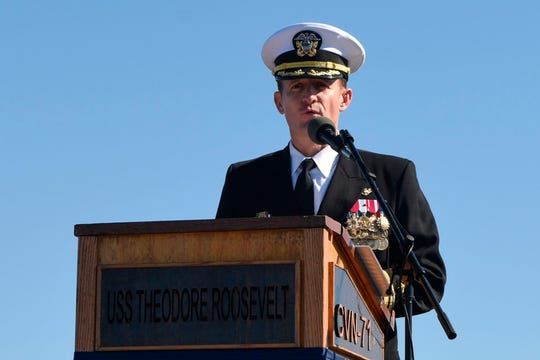 This handout photo released by the US Navy shows Captain Brett Crozier addressing the crew for the first time as commanding officer of the aircraft carrier USS Theodore Roosevelt (CVN 71) during a change of command ceremony on the ships flight deck in San Diego, California on November 1, 2019.