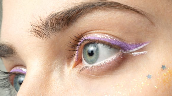 Play up your eyes with a bold eyeliner look.