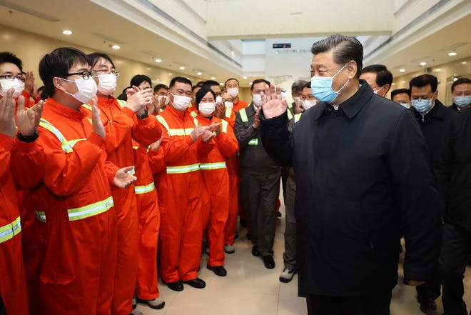 Chinese President Xi Jinping visits the Chuanshan port area in east China's Zhejiang Province on March 29, 2020.