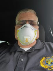 Sheriff Michael G. Mastronardy dons a face mask on Saturday, April 4, 2020.