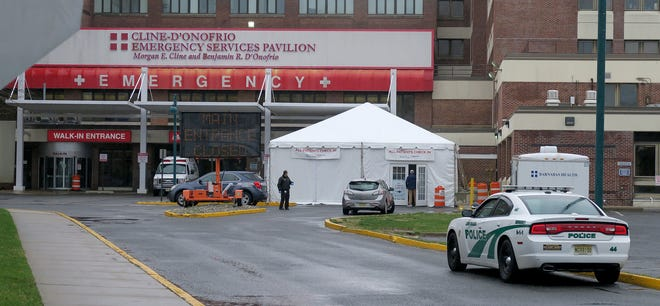 Walk in patients to Monmouth Medical Center in Long Branch enter through a tent outside the emergency room.