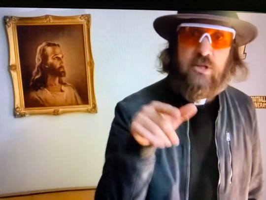 Rev. Dave Swantek raps about God and John the Baptist, as seen on YouTube.