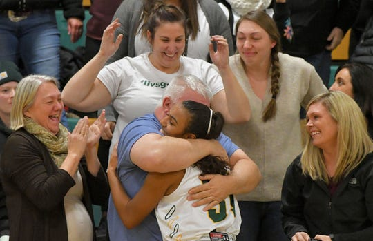 Olivia Rockwood hugs her uncle Ross Farnsworth after scoring her 1,000th point during the 2018-19 season.