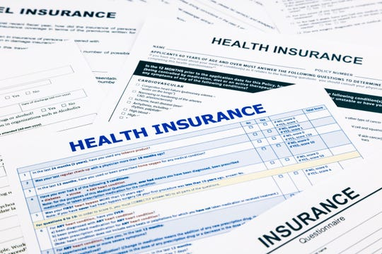 Health insurance form, paperwork and questionnaire for insurance concepts.