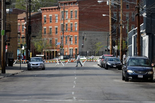 Cincinnati police closed a section of Walnut Street north of Liberty Street, Saturday, April 4, 2020, following a block party the night before in Cincinnati's Over-the-Rhine neighborhood.