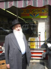 Aaron Rubashkin outside his Brooklyn butcher shop on June 3, 2008. Rubashkin, whose Agriprocessors factory was raided by ICE in 2008, died from coronavirus in April.