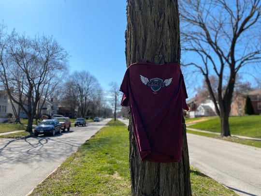 Kaydee Bobbitt, 33, was fatally shot while driving in Des Moines' Drake neighborhood on April 3, 2020.  Mothers from the ICUD Eagles football team, where her son played, put up an Eagles shirt in display at the crime scene on Kingman Boulevard.