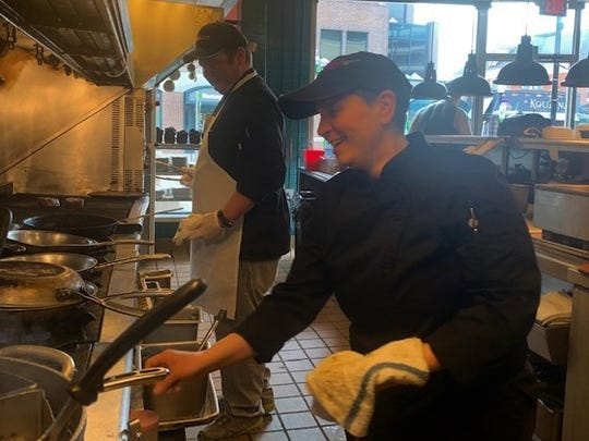 Andy Jacobs, left and Dimitra Nikolakou cook last week at Palio in Ann Arbor.