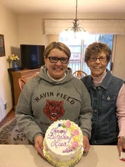 Lisa Ewald, left, celebrates a birthday with her mother, Marian Kraatz. Ewald had recently lost her mother.
