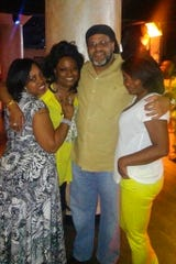 A photo provided by the Barksdale family shows siblings, from left, Sherita Johnson, Laneeka Barksdale, Omari Barksdale and Tionna Matthews. Laneeka Barksdale loved spending time with her family. Her brother, Omari, said she had an infectious smile and loved to dance. She died March 23, 2020, of COVID-19 complications.
