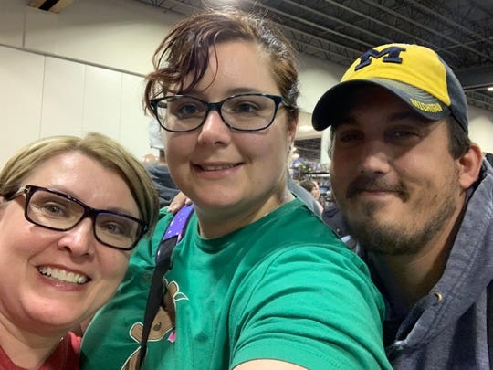 Lisa Ewald, left, poses for a picture with niece Mandi Standifer, center, and nephew Micah Standifer, left, at Motor City Comic Con in 2019.