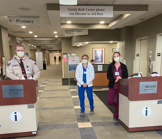McLaren clinical team at screening point for employees and visitors.  Early in the coronavirus crisis, McLaren like most hospitals, began screening employees and shutting down most visitor access to limit the potential spread of the coronavirus.