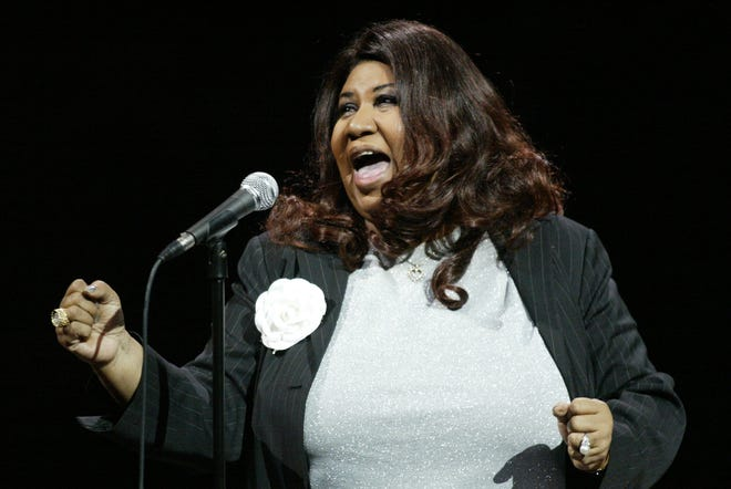 Aretha Franklin sings the national anthem prior to the start of Game 5 of the NBA Finals, Tuesday, June 15, 2004, at the Palace of Auburn Hills.