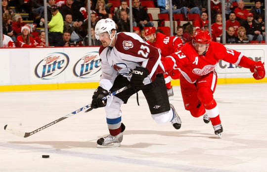 Avalanche forward Milan Hejduk, left, is chased by Red Wings center Pavel Datsyuk at Joe Louis Arena in 2008.