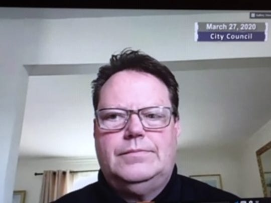 Warren City Council president Patrick Green opens the body's March 27 meeting, conducted remotely and broadcast through the city's community access channel.