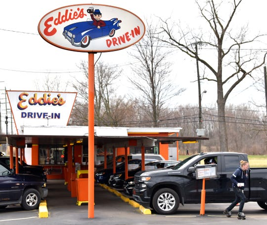 Co-owner Sharyl Uhl, of Clinton Twp., skates to another patron to take their order at Eddie's Drive-In in Harrison Twp., Saturday afternoon, April 4, 2020. Because of the COVID-19 pandemic, they've opened for the season about three weeks early to give folks somewhere new to visit as vehicles park in every other space to respect social distancing with orange cones in the empty parking spaces.