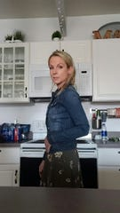 Aimee Immel, 47, of Fowlerville, in her kitchen.