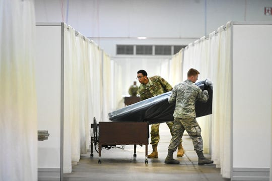 The US was totally unprepared for coronavirus despite years of infectious disease warnings. Michigan National Guard members move beds for patients with coronavirus at the TCF Center.