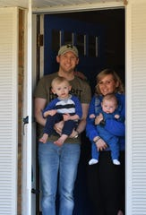 From left, Ryan and Amanda May Schreiber with their sons, Luke, 22 months, and Alistair, four months, at their home in Farmington Hills, Mich. on April. 3, 2020.  Luke received a positive COVID-19 diagnosis earlier this week. As of Friday, he still had a fever but no signs of respiratory disease.