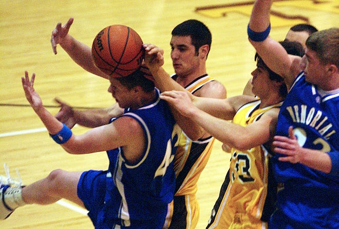 Memorial's Mitchell Brothers (43) and Patrick Blake (23) battles with Central's Kyle Taber and Preston Mattingly (33) for the ball during the first half of their game at Central High School on Feb. 17, 2004.