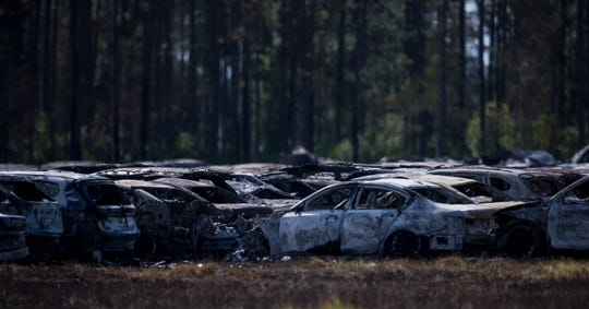Burned vehicles at the scene Saturday, April 4, 2020, of a massive fire that involved rental cars just south of Southwest Florida International Airport. There were 3,516 cars destroyed or damaged by the fire and 3,850 remained undamaged, Vicki Moreland said.