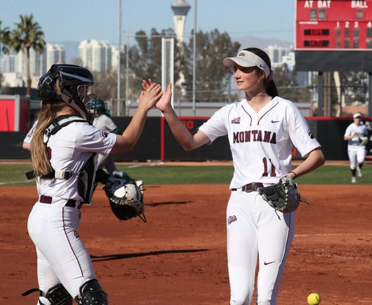 Montana pitcher Tristin Achenbach gets the glad hand from catch Jessica McAlister after recording an out against Utah Valley earlier this year.