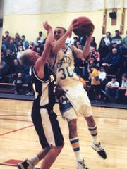 Chester's Jeff Graham (30) drives to the basket as Belt's Zach Bumgarner defends during this Northern C game from 2001.