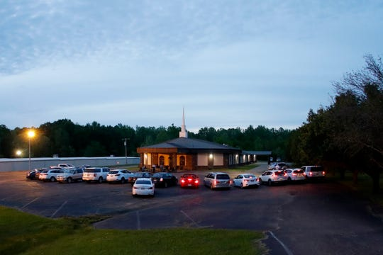 Congregants remain in their cars during a prayer service held outside at First United Pentecostal Church, Thursday, April 2, 2020, in Brandon, Miss.