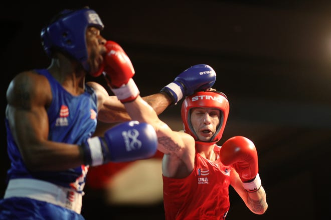 Javier Martinez fights Joseph Hicks during the 2020 U.S. Olympic boxing trials on Dec. 15, 2019, in Lake Charles, Louisiana.