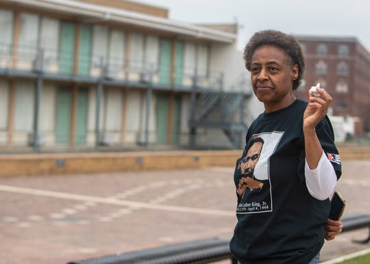 A woman visits the National Civil Rights Museum, formerly the Lorraine Motel, on the 52nd anniversary of the assassination of Rev. Martin Luther King Jr., Saturday, April 4, 2020, in Memphis, Tenn. The woman requested her name not be used.
