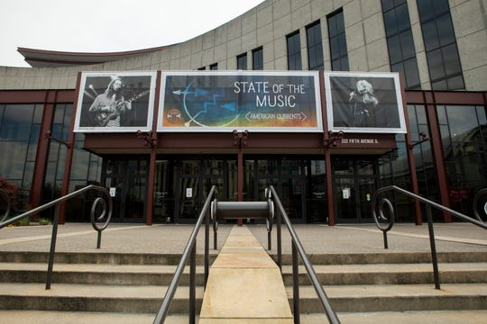 The entrance to the Country Music Hall of Fame and Museum is deserted as it remains closed due to the coronavirus pandemic in Nashville, Tenn., Saturday, April 4, 2020.