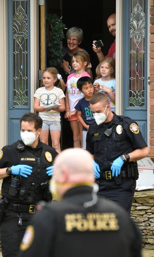 The entire family comes out to watch as Mt. Juliet Police officers visit elementary school age children celebrating a birthday during the COVID-19 crisis in Mt. Juliet, Tenn. Friday, April 3, 2020.