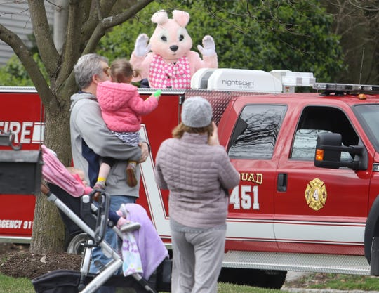 """Lt. Kerry Ann Conklin and the Easter Bunny on the back of a fire truck on Duck Pond Lane during their trip through Ramsey. Due to Social Distancing protocols, the Ramsey Fire Department cancelled its annual Breakfast with the Easter Bunny event but to keep a sense of """"normalcy"""" and to bring some happiness to the children (and adults) of Ramsey, the Ramsey Fire Department held an Easter Bunny Tour through the streets of town."""