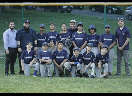 Flores (bearded) with his Cowboys team in Paterson Old Timers Youth Baseball League.