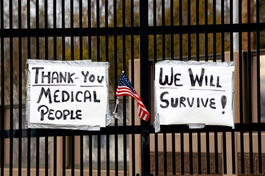 Signs thanking medical workers are hung on Park Avenue in Rutherford.